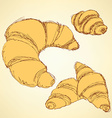 Sketch croissants set in vintage style vector image