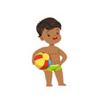 cute little boy standing with a ball kid playing vector image