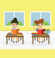 cute little girls sitting at desk and reading vector image vector image
