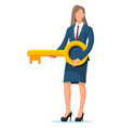 businesswoman in suit holding big golden key vector image