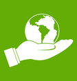world planet in man hand icon green vector image
