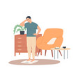 man at home stands on scales and looks at them vector image
