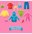 baby clothes background with clothing items