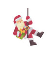 santa claus rappelling with a present in hand vector image