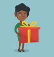 young african woman holding a box with gift vector image vector image