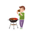 young man cooking and eating barbecue cartoon vector image