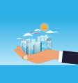 businessman holding cityscape or buildings in hand vector image vector image