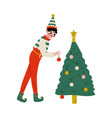 christmas elf character decorating christmas tree vector image