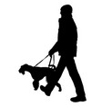 silhouette of man and dog on a white background vector image vector image