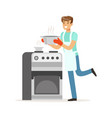 young smiling man cooking in the kitchen house vector image vector image