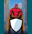 superhero holding shield on street vector image vector image