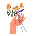female hand holding flower bouquet in bloom vector image vector image