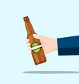 right hand holding a beer bottle and blue vector image vector image