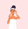 young woman applying eye drop dressed in towel vector image