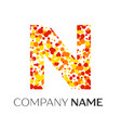letter n logo with orange yellow red particles vector image