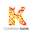 letter k logo with orange yellow red particles vector image
