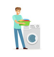 young smiling man doing laundry holding basin vector image