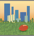american football ball on cityscape vector image vector image