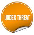 Under threat round orange sticker isolated on vector image