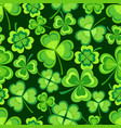 background seamless pattern with shamrock vector image