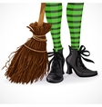 Halloween witch legs in boots and with broomstick