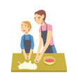 mom and her son cooking dumplings parent spending vector image