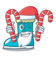 santa with candy winter boot in shape cartoon vector image vector image