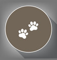 animal tracks sign white icon on brown vector image