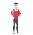caucasian groom holding a big red heart vector image