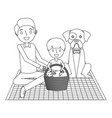 dad and son their dog sitting on picnic blanket vector image