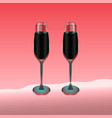 two wine glasses filled with red drink on red vector image