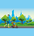 father and child on a tricycle vector image