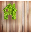 Leaves home icon on wooden EPS10 vector image