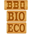 Nameplate of wood with words BBQ BIO ECO vector image vector image