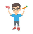caucasian boy holding fresh carrot and steak vector image vector image