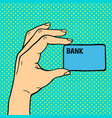 pop art hand with money card vector image vector image