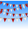 red and white flags on sky background vector image
