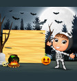 happy kid wearing skeleton costume stand beside th vector image vector image