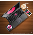 heart shape on laptop and mobile phone with coffee vector image
