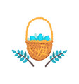 basket of colored easter eggs and green spring vector image