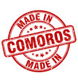 made in comoros red grunge round stamp vector image vector image