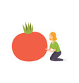 young woman sitting next to a huge tomato healthy vector image