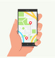 hand holding phone with map and mobile navigation vector image
