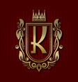 golden royal coat of arms with k monogram vector image vector image