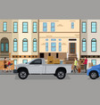 moving couple loading stuff into their car vector image vector image
