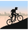 Cyclist in rough road against city landscape vector image vector image