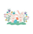 easter rabbits with eggs and flowers icon vector image