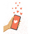 a female hand holds a phone and send red hearts vector image vector image