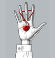 female hand palm with a red heart on ribbon vector image