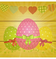 Easter eggs and bunting on wooden background vector image